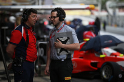 Arden International Team Manager, Richard Dent, speaks with a Pirelli engineer