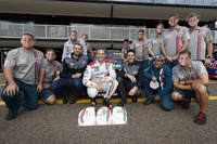 Supercars Photos - Craig Lowndes, Triple Eight Race Engineering Holden celebrates his 600th Supercars race with teammates Jamie Whincup, Triple Eight Race Engineering Holden and Shane van Gisbergen, Triple Eight Race Engineering Holden