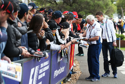 Paul di Resta, Williams Reserve Driver and Pat Symonds, Williams Chief Technical Officer signs autographs for the fans