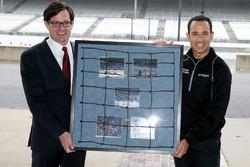 Helio Castroneves, Team Penske Chevrolet receives a piece of IMS fencing