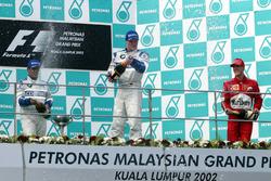 Podium: second place Juan Pablo Montoya, Williams; Race winner Ralf Schumacher, Williams; third place Michael Schumacher, Ferrari
