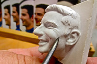 IndyCar Photos - Sculptor William Behrends adds finer details to the ceramic likeness of 2016 Indianapolis 500 winner Alexander Rossi's image before it is cast in sterling silver