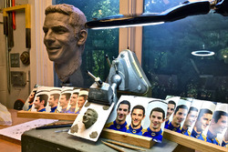 Using the life size image he created from Rossi's visit and from photos taken the day after the 100th Indianapolis 500, Will Behrends began sculpting a clay image the size of the face that would be attached to the Borg-Warner Trophy