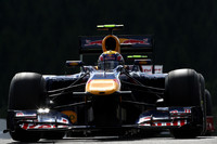 Webber charges to the pole in rainy Belgium