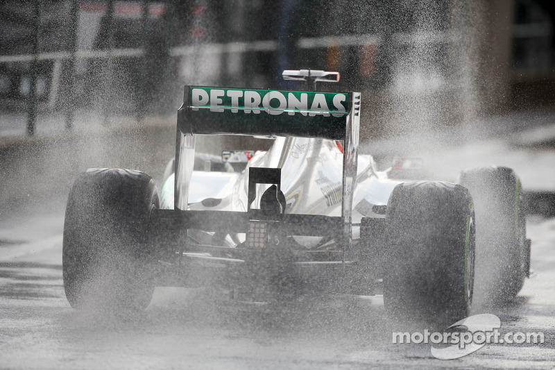 Rosberg and Schumacher survive wet conditions at Spa