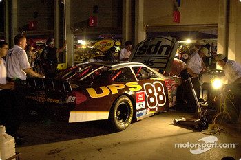 Dale Jarretts crew work by the power of generator lights after the power went out at Charlotte.