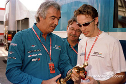 Jenson Button showing his 'Bernie' award to Flavio Briatore