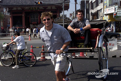 Team Player's driver Alex Tagliani shows off his rickshaw driving skills to passenger and teammate Patrick Carpentier in front of the entrance to Asakusa Temple in Tokyo.