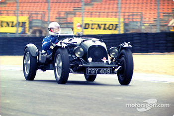 Old car, modern helmet…