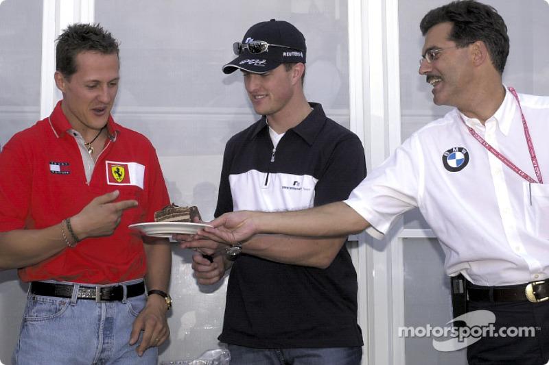 Michael Schumacher, Ralf Schumacher and Mario Theissen celebrating Ralf's 26th birthday
