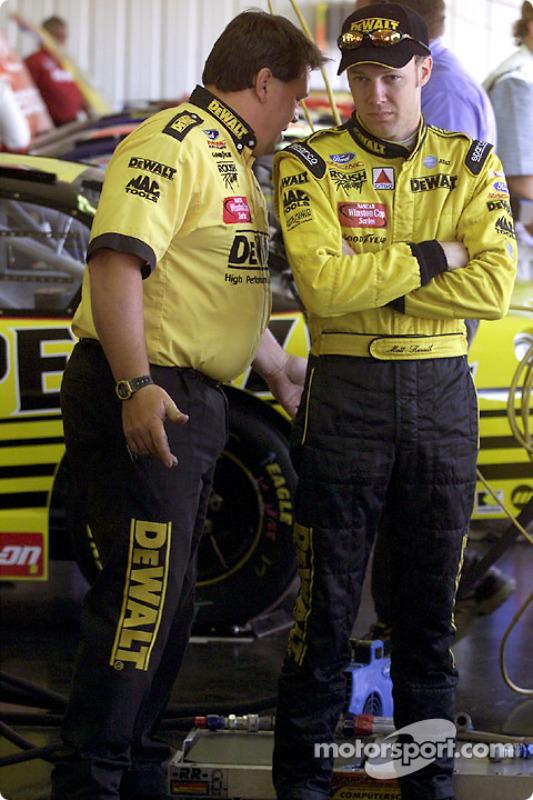 Matt Kenseth confers with crew chief Robbie Rieser in the garage area at Pocono