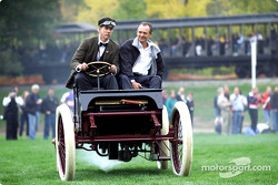 Ford's Glenn Miller and drag racing great Bob Glidden head for the finish line in an reenactment of Henry Ford's 1901 race victory over Alexander Winton