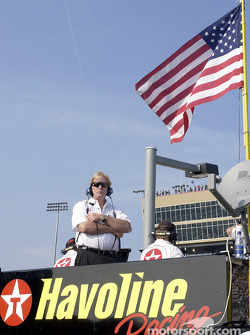 Robert Yates watches from atop the Texaco Havoline team pit box as driver Ricky Rudd's title hopes fade