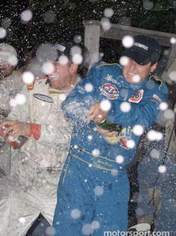 Devon Powell sprays champagne at Road America after earning his fifth-straight win of the season