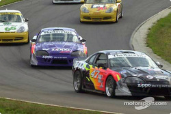 Three SGS cars work their way through the esses at Virginia International Raceway during a caution on the first lap of the race