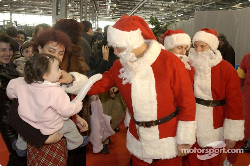 The traditional Children's Christmas at Ferrari: Michael Schumacher, Luca Badoer and Rubens Barrichello
