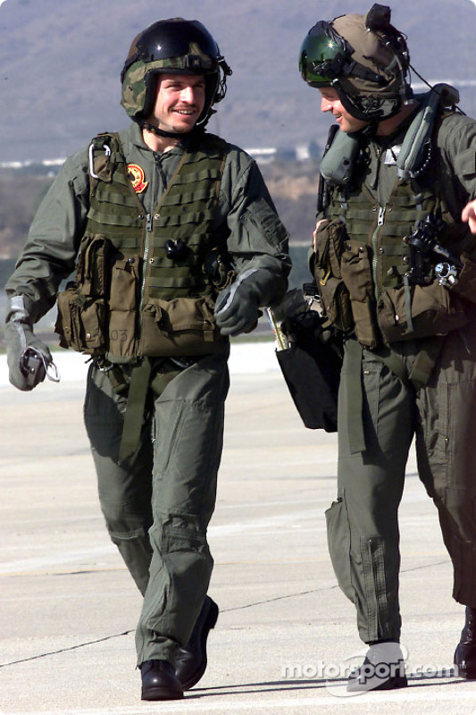 Patrick Carpentier chats with Captain Aaron Marx upon their return from a training mission aboard a AH-1W Cobra helicopter