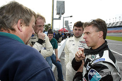 Drivers (right to left) Jan Lammers, Tony Stewart, and James Weaver talk with a crewman during Daytona testing on Saturday