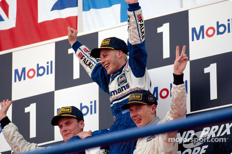 The podium: World Champion Jacques Villeneuve with David Coulthard and Mika Hakkinen