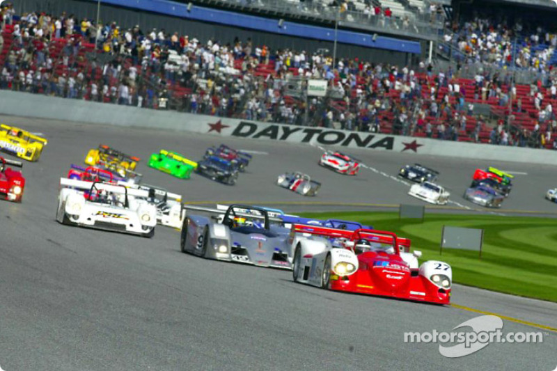 Didier Theys taking the lead as the field races into turn one at the start of the Rolex 24 at Daytona