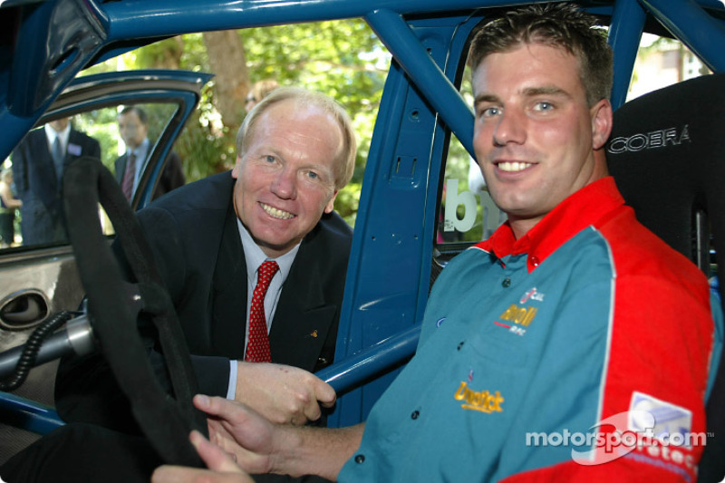 Queensland Premier Peter Beattie is given a tour of a V8 Supercar by Caltex-Havoline Ford driver David Besnard; the V8 Supercars will return to the streets of Surfers Paradise in October and will be competing for championship points for the first time