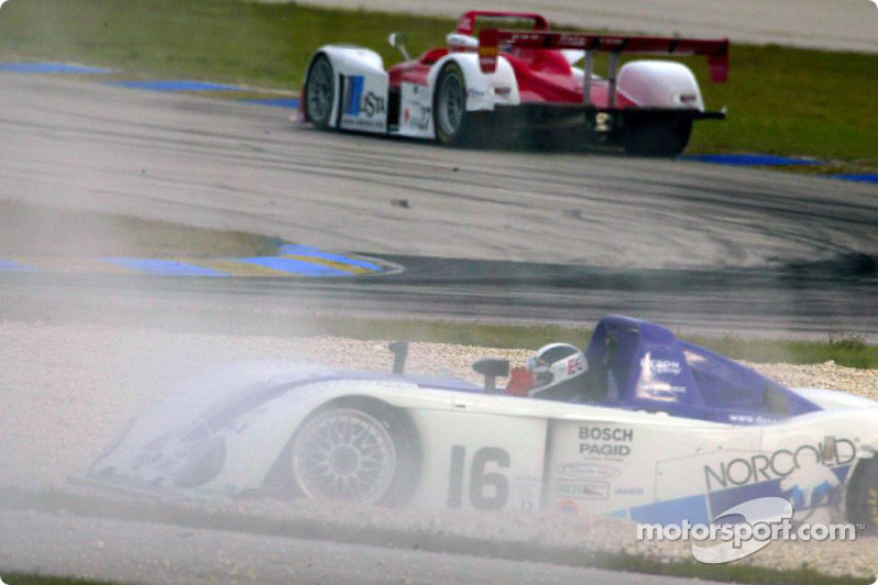 James Weaver in the Dyson Racing Team #16 Judd Crawford slides into a gravel trap after his left rear suspension gives out, giving Mauro Baldi, in the Doran Lista Racing #27 Judd Dallara, the lead at the Nextel 250