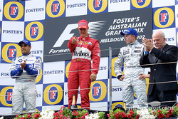 The podium: race winner Michael Schumacher, with Juan Pablo Montoya and Kimi Raikkonen