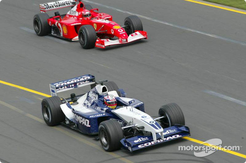 Juan Pablo Montoya leading Michael Schumacher