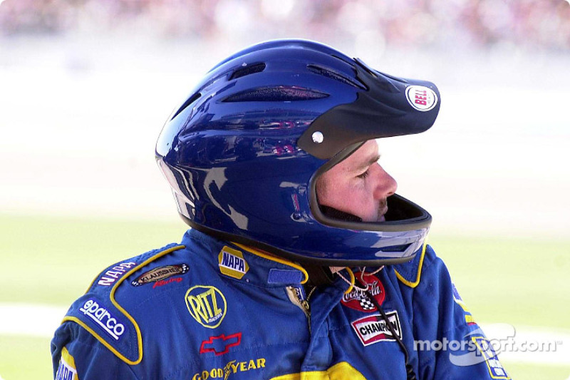 All over-the-wall crew members are required to wear helmets; this rule was put into effect at the first race of the 2002 season and Greg Osborne changes rear tires for the NAPA team