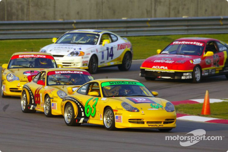 A pack of Grand-Am Cup cars races around a turn on California Speedway's new road course during Thursday's practice session