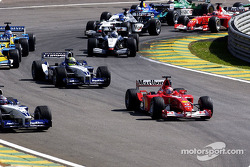 First corner: Michael Schumacher about to pass Juan Pablo Montoya