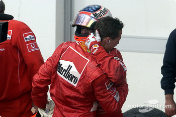Michael Schumacher being congratulated by Rubens Barrichello