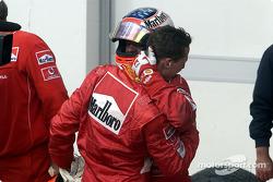 Michael Schumacher being congratulated by Rubens Barrichello