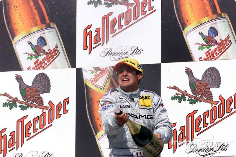 The podium: Jean Alesi