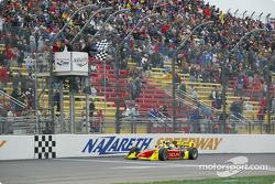 Scott Sharp taking the checkered flag
