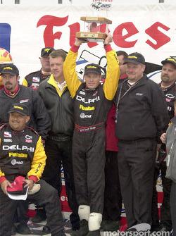Scott Sharp displays his trophy