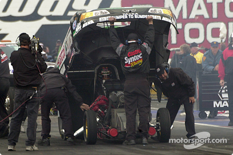 A final adjustment to Tony Pedregon's funny car