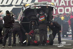 A final adjustment to Tony Pedregon's funny car