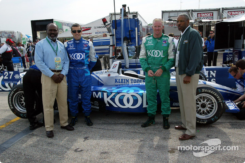 Dr. Earl Wheatfall, President of the 100 Black Men of America Milwaukee chapter (left), and Bill Simms, National President of the 100 (right), with Dario Franchitti and Paul Tracy prior to the start of the race
