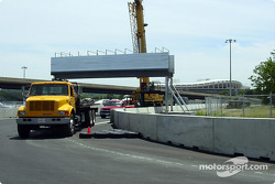 Construction photos of the Cadillac Grand Prix of Washington, DC: one of three pedestrian bridges on the grounds of the track, this bridge is located near turn five