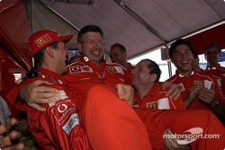 Michael Schumacher, Ross Brawn and Jean Todt celebrating