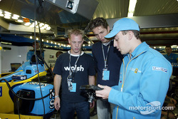 Fernando Alonso showing swimmer Pieter van den Hoogenband and Dutch Speed Skater Jochem Uytdehaage the RenaultF1 steering wheel