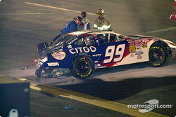 Jeff Burton scrambles out of the car a bit faster