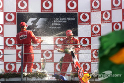 The podium: champagne for race winner Rubens Barrichello and Michael Schumacher