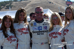 A happy Kelly Collins with the Hawaiian Tropic girls in Nomex