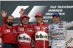 The podium: race winner Michael Schumacher with Rubens Barrichello and Kimi Raikkonen