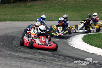 #28-Adam Pecorari, of Aston, PA, leads Formula Yamaha Junior Racers up the fourth turn hill
