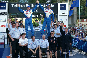 The podium: winner Marcus Gronholm celebrates with Team Peugeot