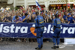 Petter Solberg and Phil Mills spray champagne on their fans