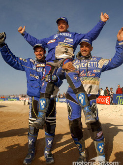 Winner Richard Sainct celebrates with Cyril Despres and Fabrizio Meoni